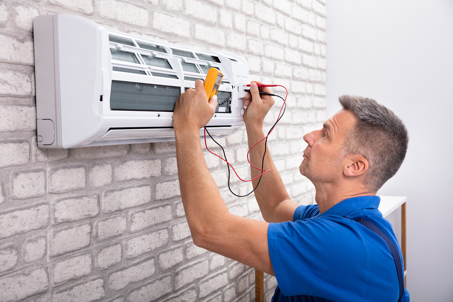 man checking the AC unit